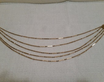 Vintage Teired Gold colored Necklace