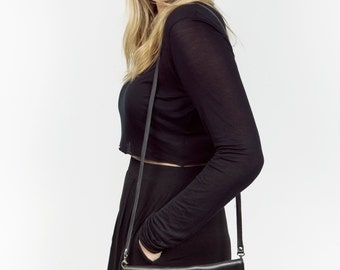 Kim | A practical and elegant clutch that can be worn in different ways