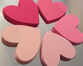 100 3 inch paper die cut hearts.  Great for scrap booking