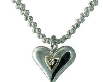 Mixed Metals Silver Heart Necklace with Min Heart set With a Diamond