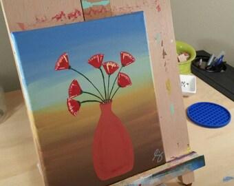 Red Flowers in Adobe Vase