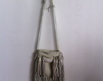 Real handmade crossbody bag, from soft leather with elements of fashionable leather fringe new women's white color bag size - small.