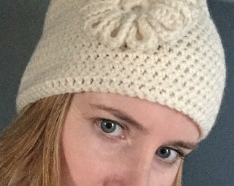 Cream colored crochet hat with flower