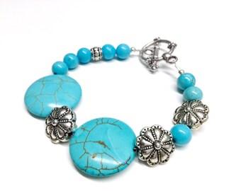 Pale blue stone and metal bracelet