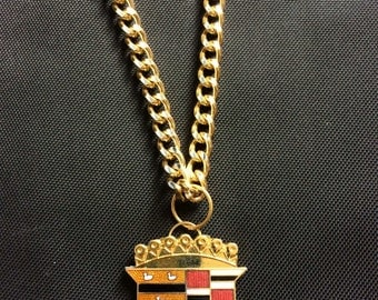 Gold Vintage Cadillac emblem necklace on gold chain