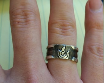 Silver ring with Fire symbol