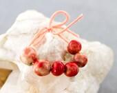 Tiny pale red glazed porcelain bead set-Ronnie's beads