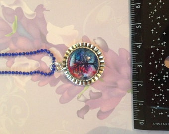 cameo necklace with blue and purple tree