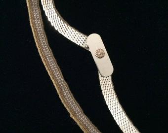 A Vintage Yellow Gold Colored  Stretch Belt. The Scales are Rounded off Rectangles.