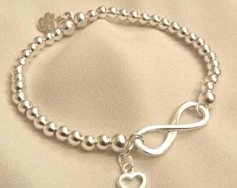 Sterling Silver Infinity  Bracelet with Open Heart Charm