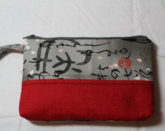 """Zipper pouch with wristlet- 8""""L x 5""""H"""