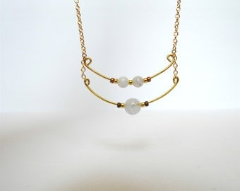 Golden necklace and chalcedony beads