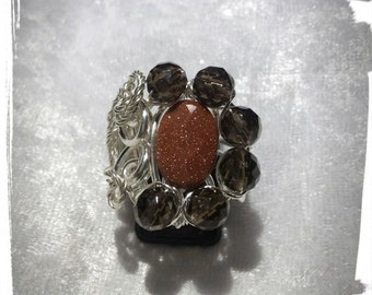 Silver plated copper with Goldstone and smoky quartz ring