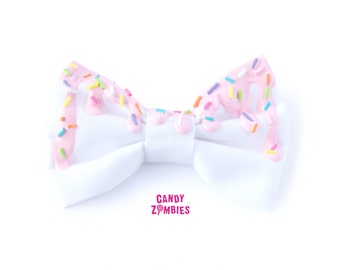 Melty white candy hair bow with baby pink frosting rainbow sprinkles