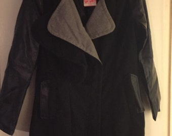 Brand new with tags. Mixed media coat. Faux leather and soft poly/wool blend. Sized XL fits like L.