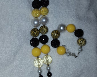 Yellow, black, and white chunky bead necklace with bracelet to match.