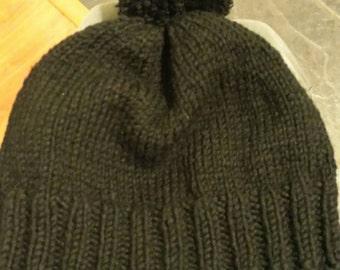 Knitted black pompom hat