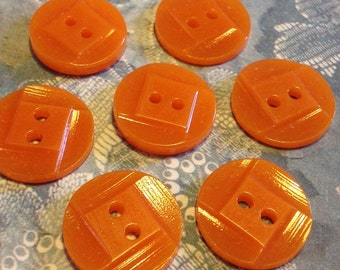 Bright orange 1940s American casein vintage buttons