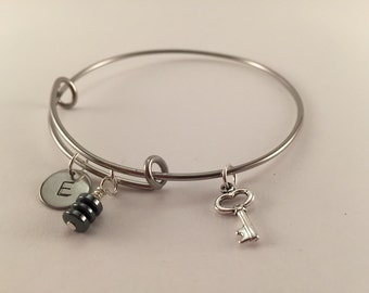 Adjustable handmade stainless steel bangle with charms