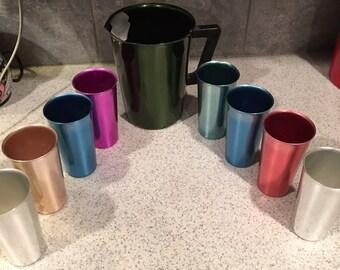 Vintage aluminum pitcher & 8 multicolor glasses