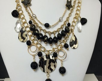 Black and gold multi strand chain necklace