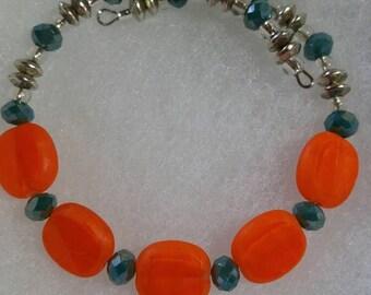 Turquoise and tangerine glass bead bracelet