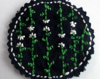 Coat flowers hand embroidered