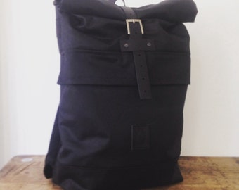 Roll top waxed cotton backpack