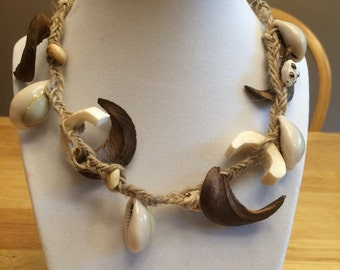 Braided necklace with shells