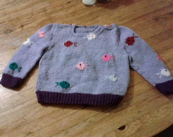 Hand knitted jumper with fish design