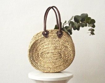 Small oval basket and leather handles