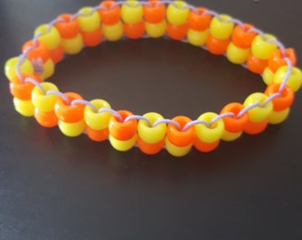 Orange and yellow neon checker double row rave kandi
