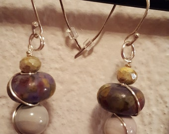 Glass beaded earrings and sterling silver.