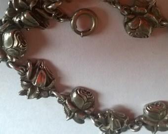 Beautiful vintage silver saints and roses bracelet