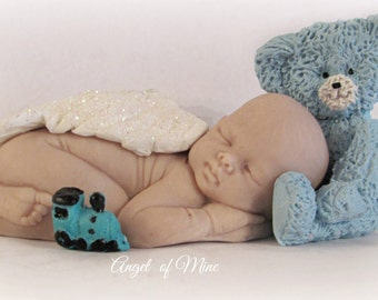 Sleeping Angel Baby with Blue Teddy Bear and Train Sculpture by Angel of Mine for miscarriage and baby loss