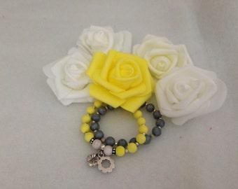 beaded yellow and grey bracelet