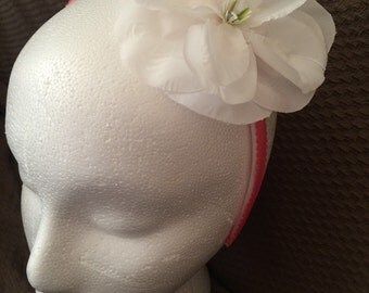 Pink Headband with a White Flower