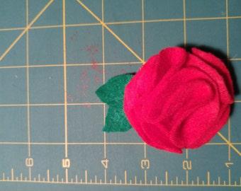 Fuchsia felt flower on a small hair clip