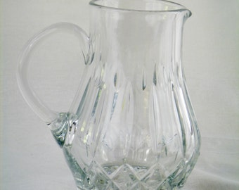 Eelgant deeply cut crystal water pitcher with applied handle
