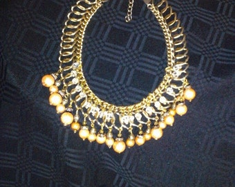 "Upcycled VINTAGE bib necklace. Gold tone 16""-20"" extension."