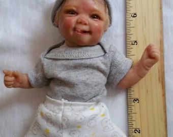 "7"" Mini ooak clay sculpted posable baby (little tongue sticking out)"