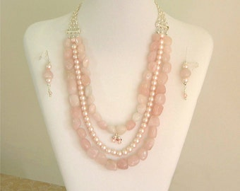 "Beautiful 24"" Multi Strand Glass Bead Necklace in soft tones of pink"