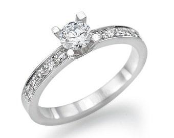 Central diamond 0.30 CT 14 k gold ring