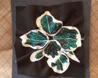 Abstract machine embroidered leaves