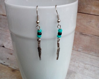 Feather and bead dangle earrings