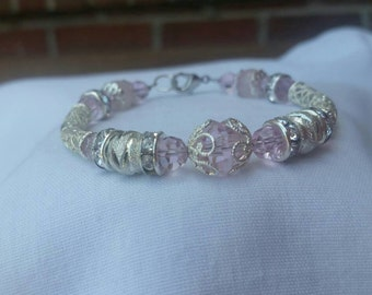 Soft pink crystal and sterling silver filigree bracelet