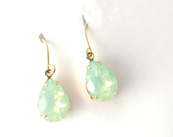 Iridescent green crystal drop earrings