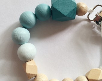 Hand-painted dummy in an ombre look with geometric wooden beads - mintblau