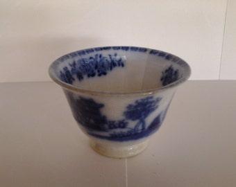 Flow blue tea bowl, circa 1840