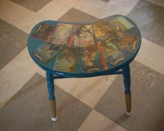 Decoupaged kidney shaped bench